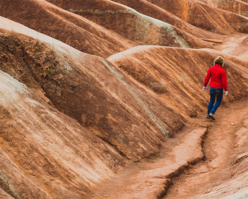 nicole raquinio photography of a girl walking down a hill on a slope called badlands