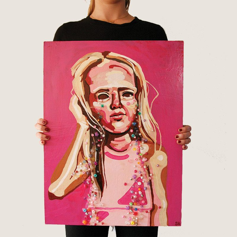 photograph of a woman holding an original abstract painting of a girl holding her head and crying candies by wunderkid artist Sienna Brown