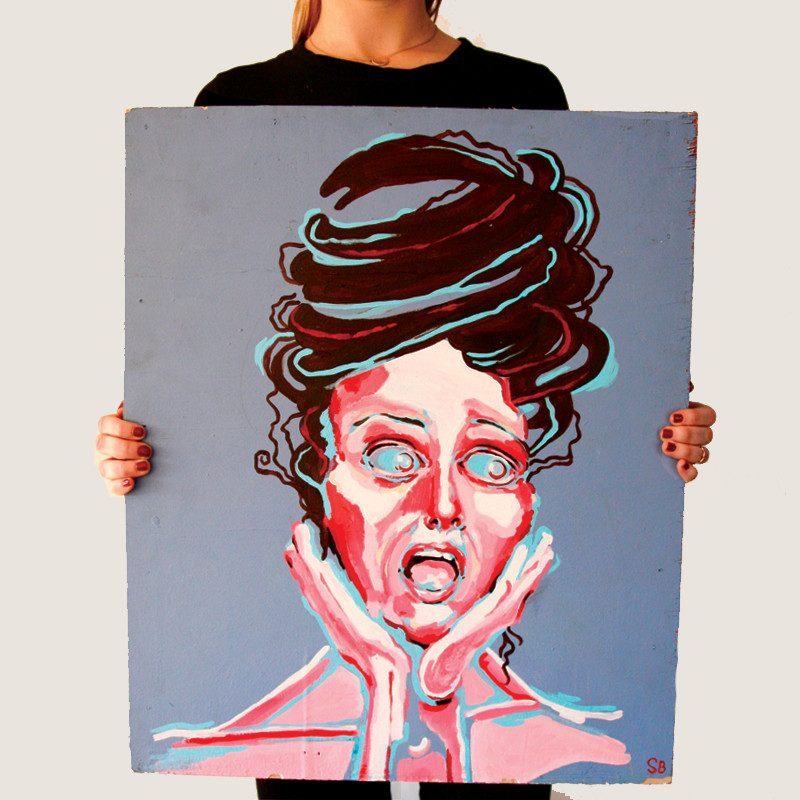 photograph of a woman holding an original abstract portrait painting of scared woman screaming with hair pulled up in a blue colored background called scream by artist Sienna Brown