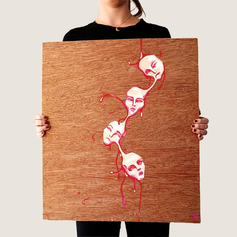 photograph of a woman holding an original abstract painting of four attached white pinky faced painted on wood by artist Sienna Brown called wax