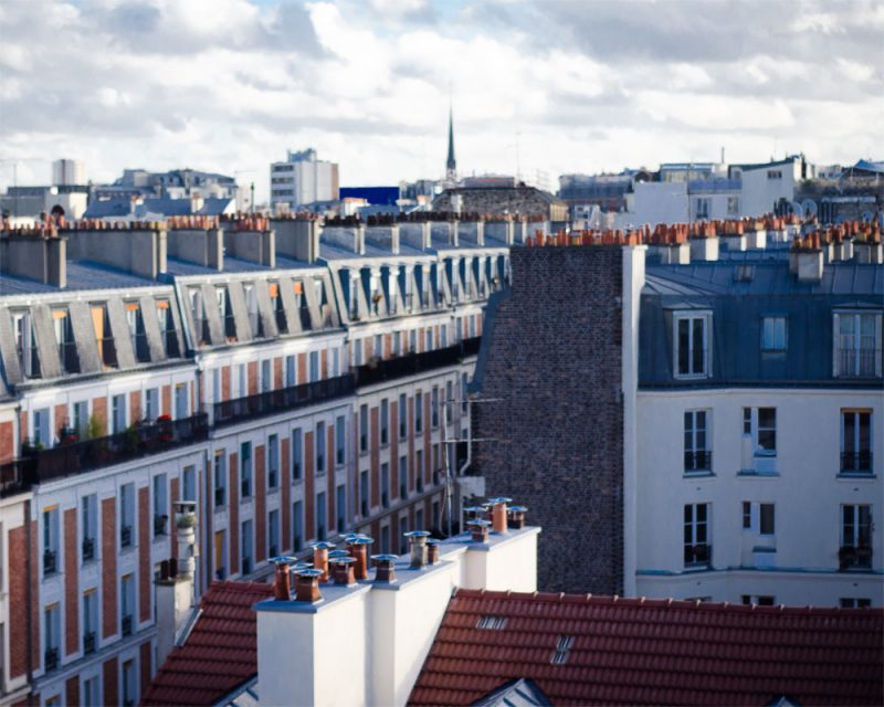 photograph of some rooftops in Paris called above by photograph photograph of subway station In New York City called the New Yorker by photograph Alexandra Bloch