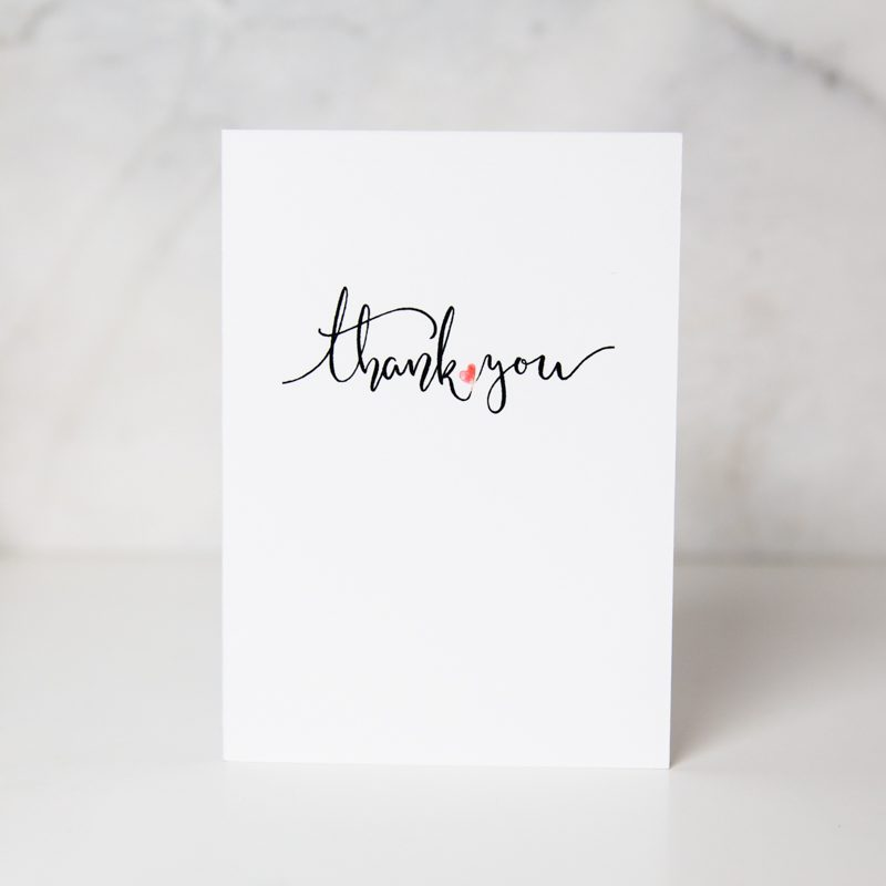thank you greeting card with thank you wording and a complete white background and a small drawn red heart between the two words called heartfelt thanks by Eleanor Lim
