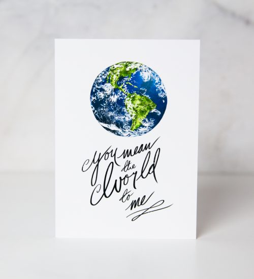 love greeting card of a colored painted earth with the You mean the world to me in a complete white background by artist Harry Woodgate