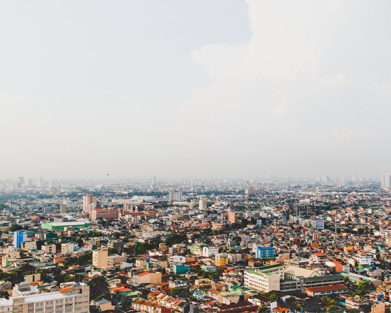 wunderkid nicole raquinio photograph overlooking a city and buildings called manila