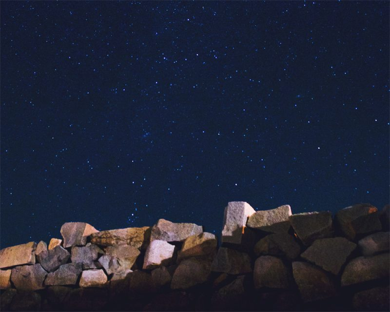 photograph by ben lasky of rocks and a dark sky called another world