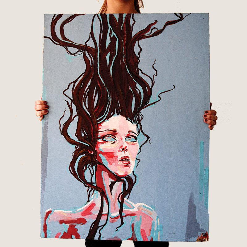 photograph of a woman holding an original abstract portrait painting of a woman looking upwards without any facial expression and hair pulled up called influx by Sienna Brown