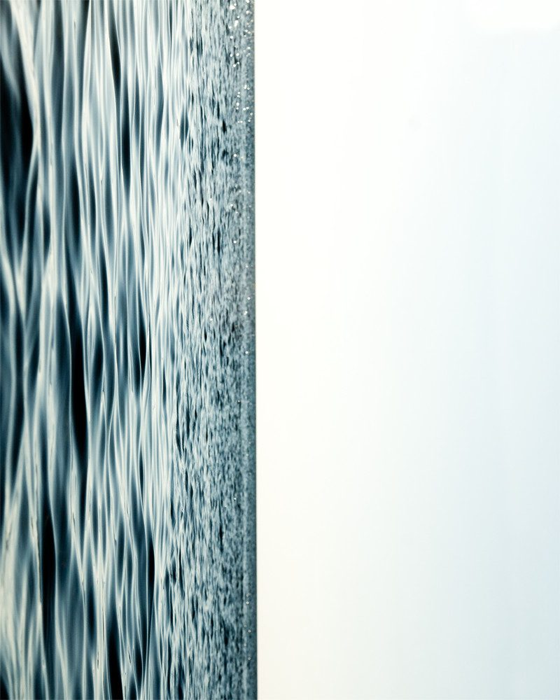 abstract photograph of the ocean and the sky called halves by artist NICOLE RAQUINIO