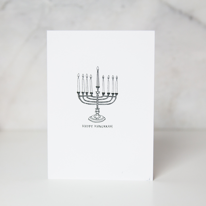 happy Hanukkah greeting card with a Hanukkah brand drawn in a complete white background by wunderkid artist Lauren Suh