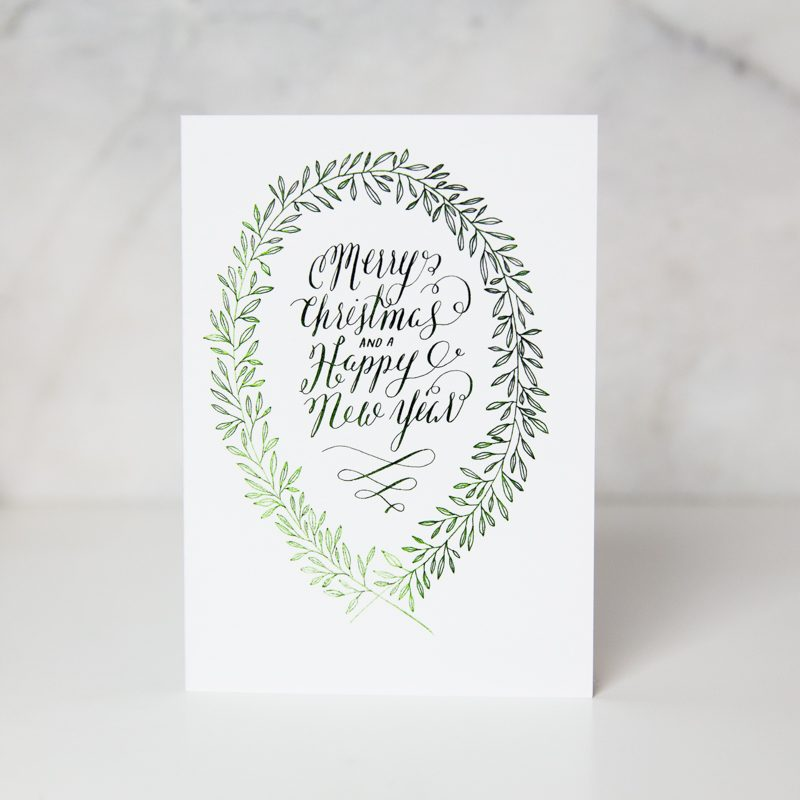 merry christmas and happy new year greeting card with holly leaves by wunderkid artist Lauren Suh