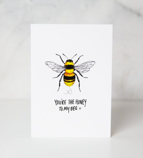 love greeting card with you're the honey to my bee wording underneath a drawn bee in a complete white background by wunderkid artist Lauren Suh