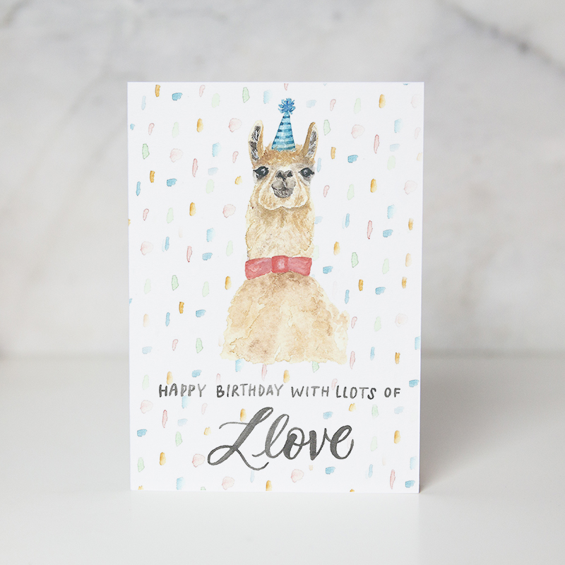 Birthday greeting card with happy birthday with lots of Llove wording underneath a painted lama and confetti around it called birthday love by artist Jordan Marshall
