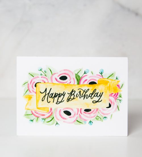 birthday greeting card with happy birthday wording written on painted banner with pink flowers behind called birthday flowers by artist Jordan Marshall