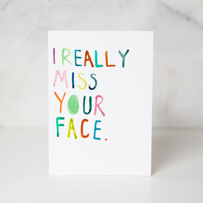 Just because greeting card with the I really miss your face wording with each letter written in different colors in a complete white background called I miss your face by artist Ida Patton