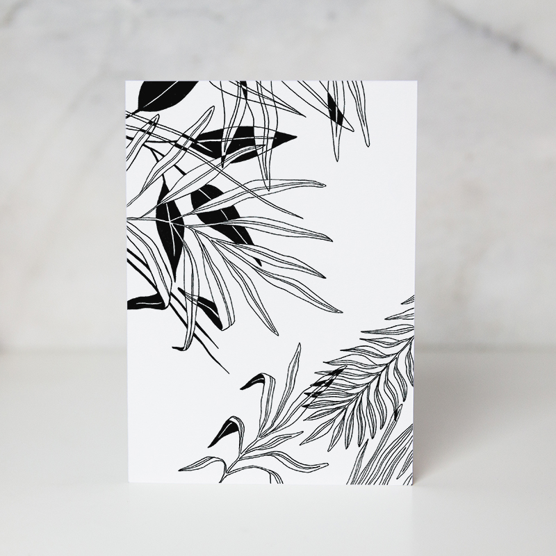 greeting card of black and white drawn leaves in a complete white background called leaves by wunderkid artist Lauren Suh