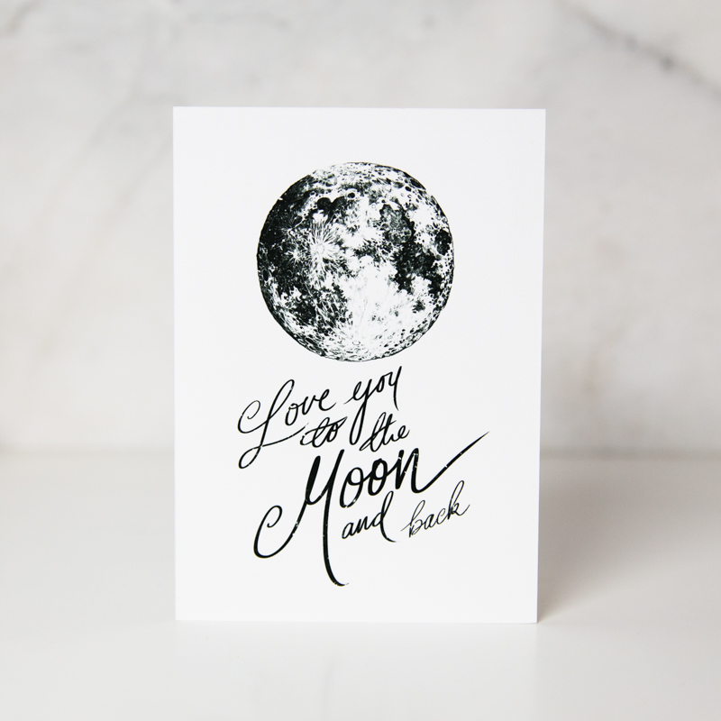 love greeting card of a black and white painted moon with the love you to the moon and back in a complete white background by artist Harry Woodgate