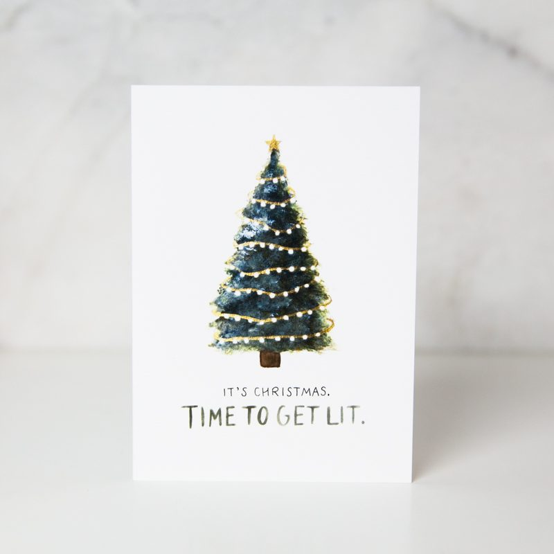 christmas card of a lighted painted christmas tree with the It's christmas. Time to get lit wording in a complete white background called get lit by artist Sarah Brown
