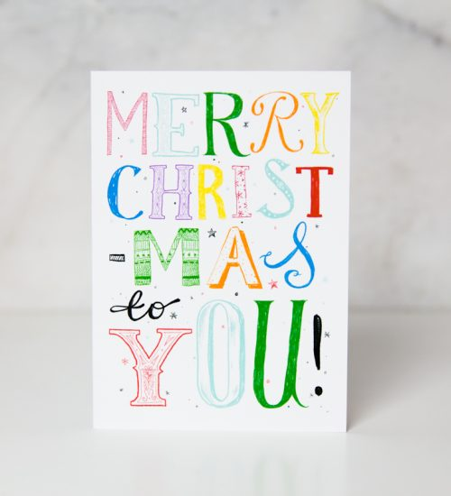christmas card with the Merry christmas to you wording written in different colors and shapes in a couple white background called merry xmas to you by artist Harry Woodgate