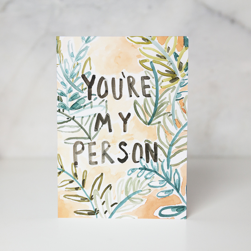 love card of some foliage painted behind the You're my person wording written in black called you're my person by artist Ida Patton