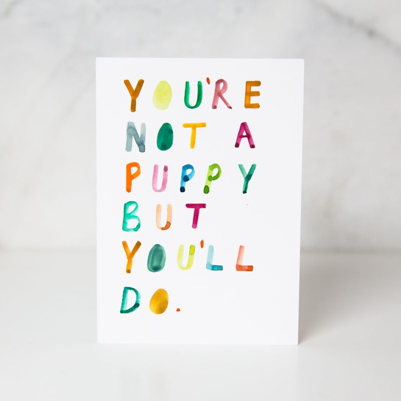 sympathy card with the You're not a puppy but you'll do with each letter written in different colors in a complete white background called you'll do by artist Ida Patton