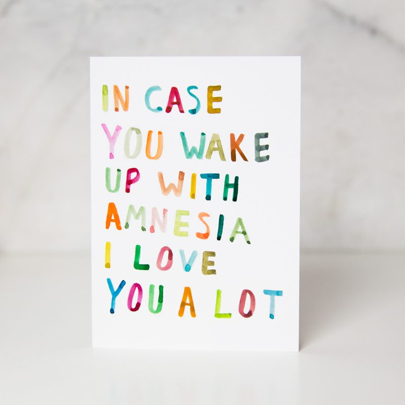 sympathy card with the In case you wake up with amnesia I love you a lot with each letter written in different colors in a complete white background called amnesia by artist Ida Patton